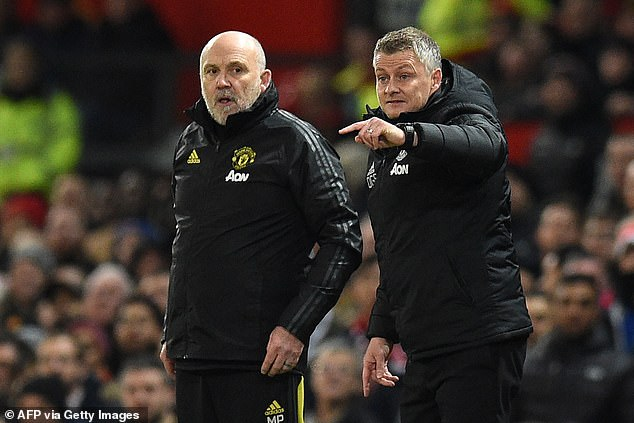 Manchester United have rewarded Mike Phelan (left ) with a new contract to stay until 2024