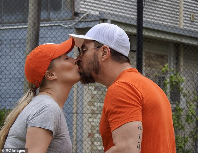 Tactile: After an hour of essential exercise, the couple roamed around the court before they put on a very tactile display