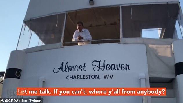 Sen. Joe Manchin addresses kayak protesters who swarmed his houseboat in Washington D.C.
