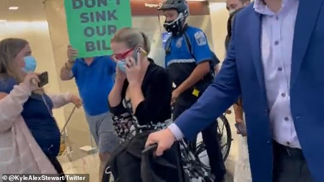 Senator Kyrsten Sinema was targeted by another group of protesters who were waiting for her at Reagan National Airport after she landed in Washington D.C. for this week's Senate session