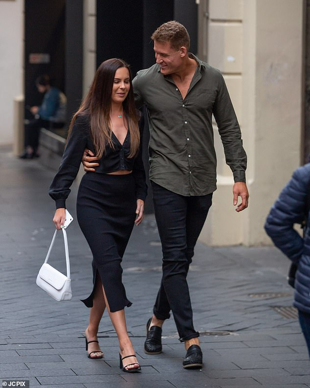 Gorgeous:Ania looked stunning for the romantic outing, showing off a hint of her tummy in a cropped cardigan and a midi skirt