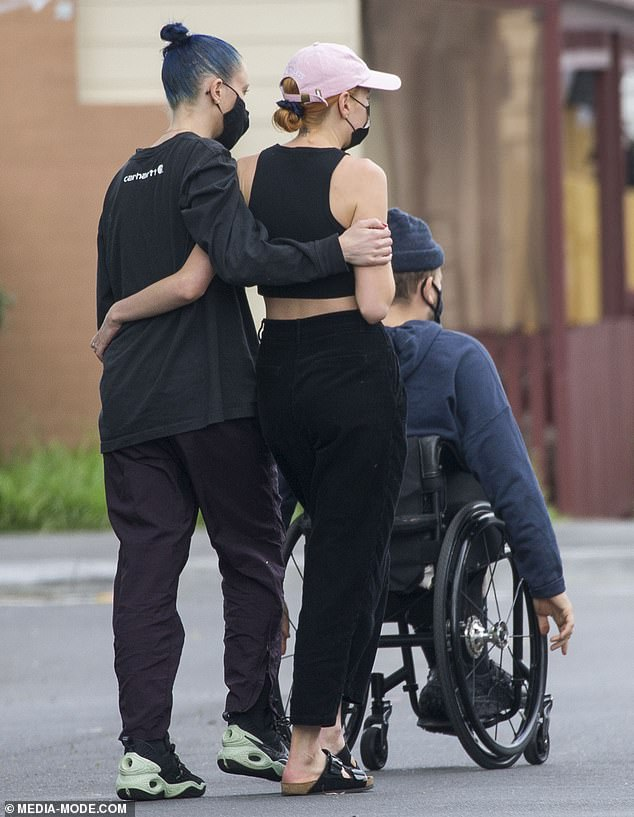 Pals:At one stage, the pair were joined by a female friend, who strolled arm-in-arm down the road with Chantelle as they waited for the removalists to finish their work