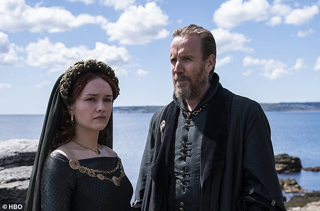 Outsiders:Olivia Cooke and Rhys Ifans were seen in another shot, donning dark green to represent their their lineage: House Hightower. The pair play Alicent Hightower, King Viserys I Targaryen's second wife, and Otto Hightower, the Hand of the King