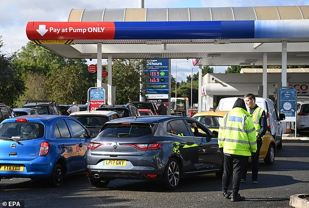 Cars queue at a Tesco garage in Frien Barnet in London last week during the fuel shortage