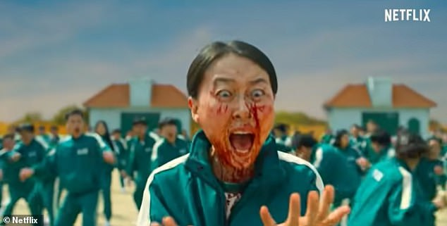 Korean-made Squid Game, which is the most streamed show in the US and in the UK, features grisly scenes of characters being shot in the head and organ harvesting. Pictured, A contestant is covered in blood after another player's head is blown off in a hellish version of aGrandma's Footsteps