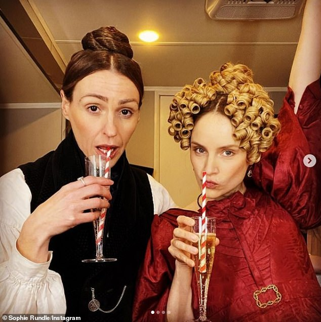 all done!  Suran Jones was in a cheery mood Tuesday as she and co-star Sophie Rundle celebrated wrapping filming for series two of Gentleman Jack