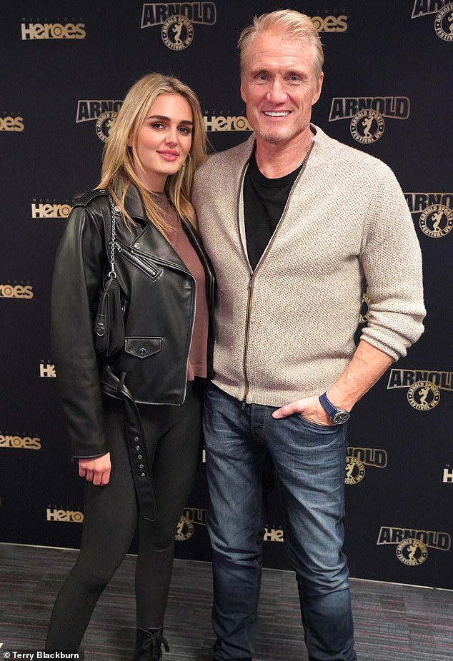The happy couple: Dolph Lundgren, 63, and his fiancée Emma Krokdal, 24, were in high spirits as they attended the Arnold Sports Festival at the Birmingham NEC on Sunday.