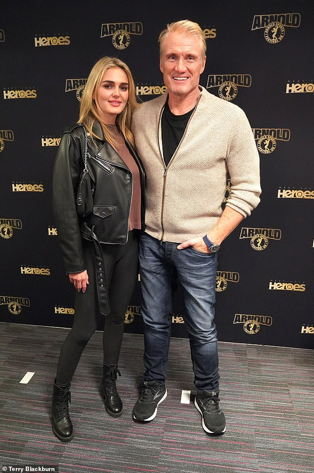 STYLISH: Dolph paired jeans with a black T-shirt under a zip-up jumper, while Emma showcased her toned physique in black leggings and a leather jacket.