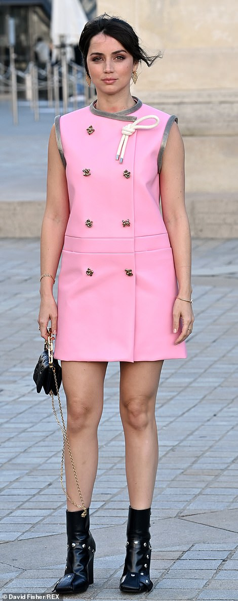 Time for style:The Bond actress, 33, looked incredible in a candyfloss hued 60s-inspired mini dress, adorned with silver butterflies as she posed up a storm
