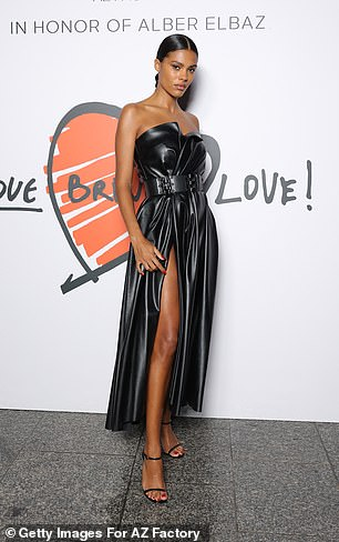 Beauty:The star, 24, cinched her waist with a matching belt while she styled her locks into a sleek updo