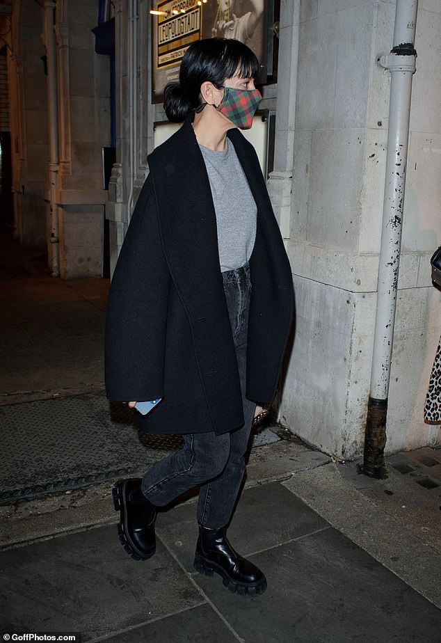 Done for the day: Singer-turned-actress Lily draped in a black coat as she leaned toward a waiting car by the stage door