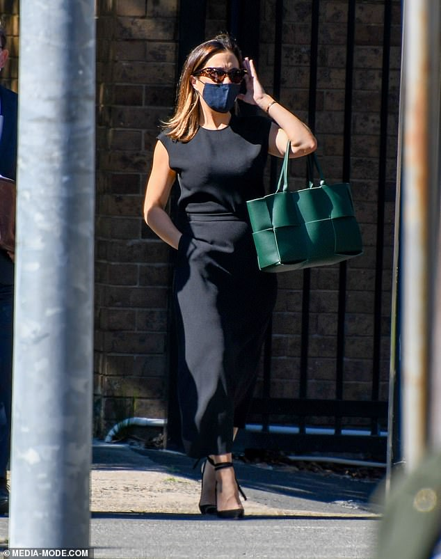 Fisher arrived at court on Wednesday wearing a sleek black dress and matching face mask