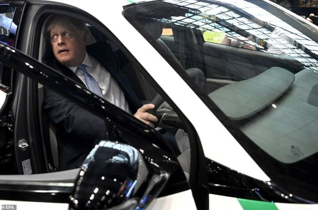 The premier also tried out a hydrogen car as he was shown around the stands at the conference centre yesterday