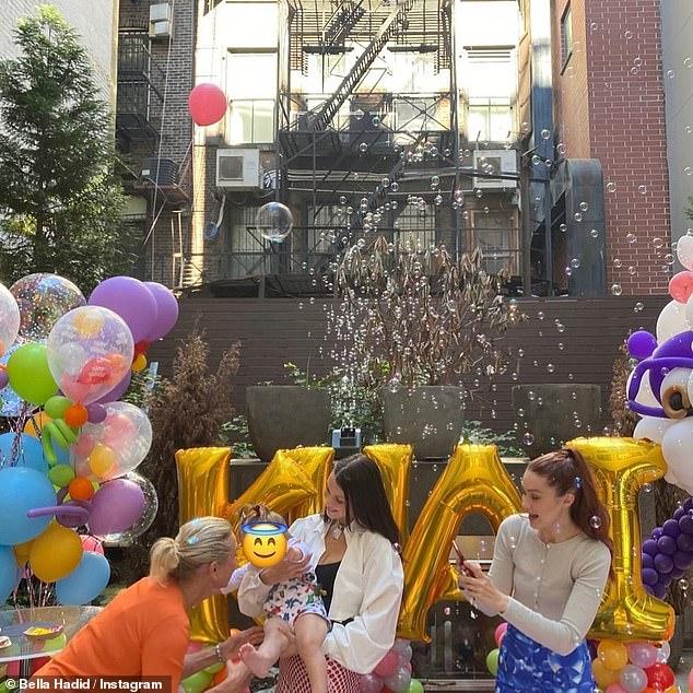 Happy birthday Khai! That same day Bella posted a slideshow capturing her niece Khai's first birthday