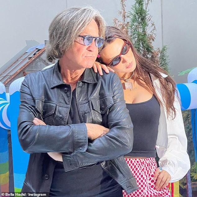 Family time! Bella leaned her head against her father Mohamed Hadid's shoulder