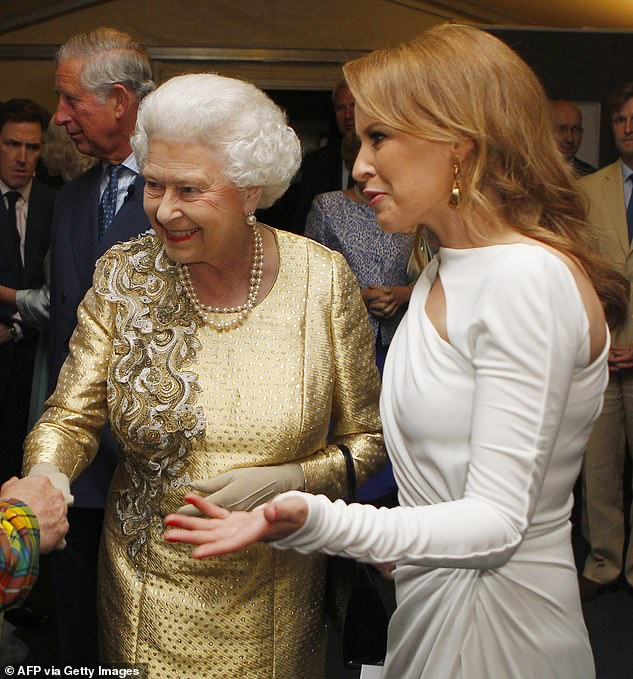 Prestigious: She was appointed an Officer of the Order of the British Empire in the 2008 New Year Honours for services to music. Pictured withQueen Elizabeth IIon June 4, 2012