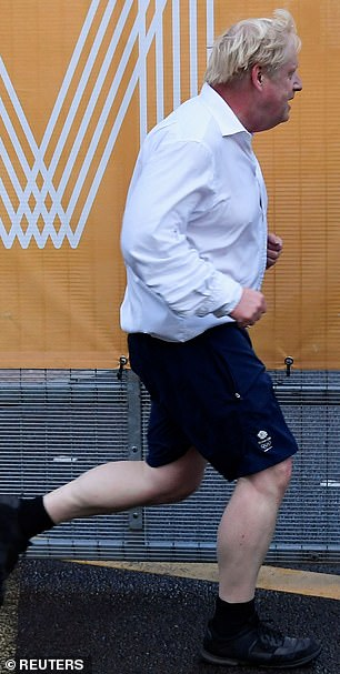 Sunday: It comes days after Mr Johnson was photographed running in a suit shirt and shorts with black socks after appearing to have forgotten his sports kit