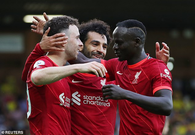 Jota has been in fine form in the Reds' front three alongside Salah and Sadio Mane (right)