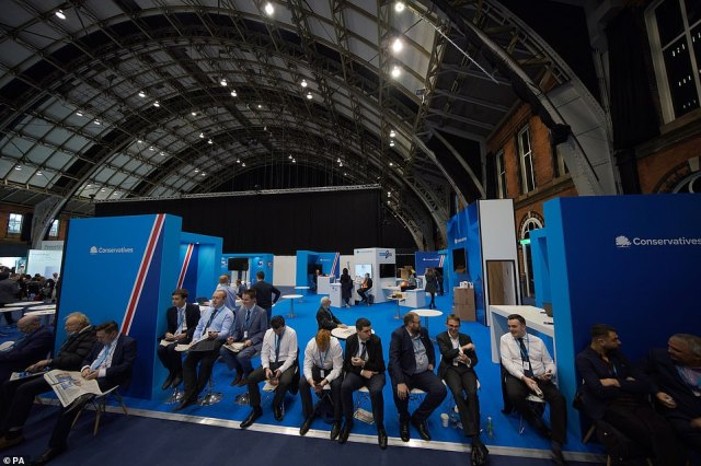 Tory members queue to get into the hall for Mr Johnson's conference speech in Manchester today