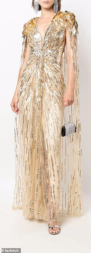 The £4,000 gown, which was originally thought to be a custom creation, is now available to buy via online retailer FarFetch. Pictured, the dress on a model