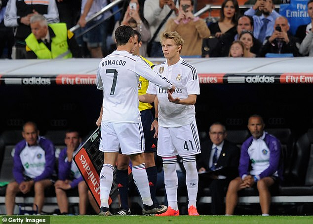 Odegaard had the chance to learn from the likes of Cristiano Ronaldo (left) at Real Madrid
