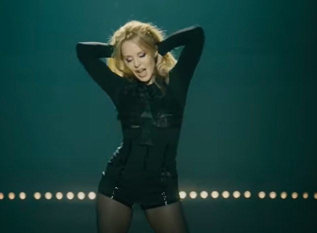 She's back!Kylie Minogue released her brand-new single A Second to Midnight featuring Years & Years on Wednesday and donned tiny black shorts to dance around in the accompanying music video