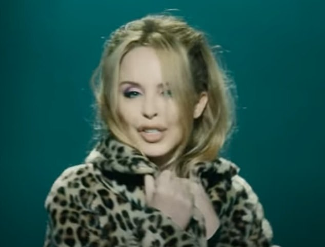 Stunning: Kylie looked stunning as she danced about in the new video wearing a leopard print fur coat