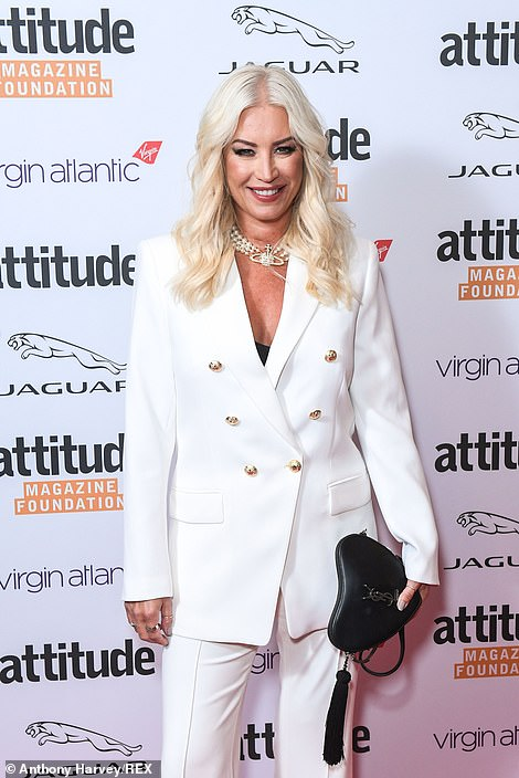 Style:Denise completed the look with a heart-shaped black bag and silver choker necklace