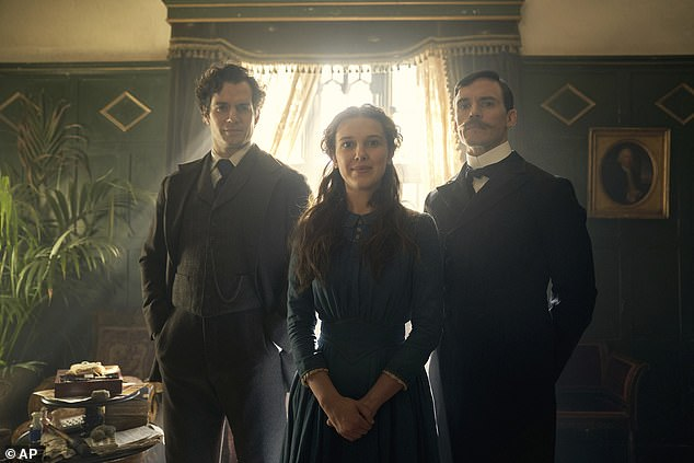 Team: the Stranger Things star (centre) will grace the small screen alongside the likes of Sam Claflin, 35, (right) and Henry Cavill, 38 (left) [pictured in-character]
