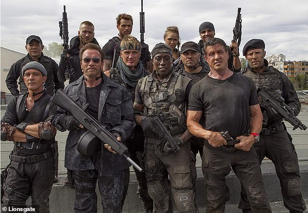 Star-studded: The photo attracted the likes of Dolph, Harrison Ford, Jean-Claude Van Damme, Wesley Snipes, Antonio Banderas, Mickey Rourke, Bruce Willis, Arnold Schwarzenegger, Mel Gibson, and more (pictured in 2014).