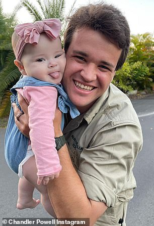 She's a cheeky girl! Grace poked out her tongue in this photo with her father Chandler Powell