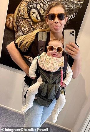 Too cute! She wore funky sunglasses while smiling with her mum Bindi