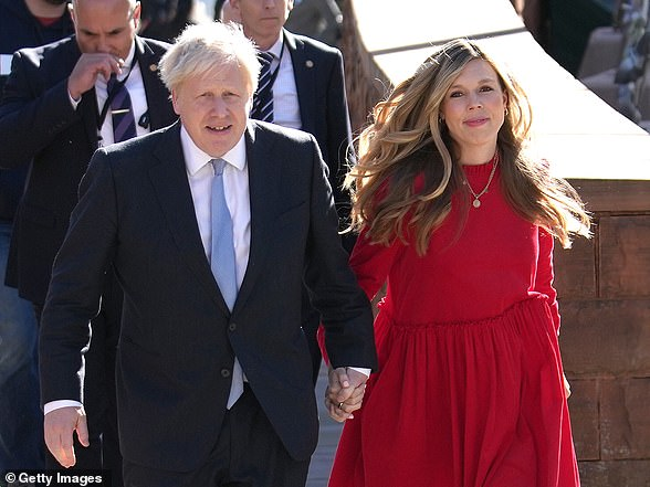 Boris (left) and wife Carrie arrive at the Conservative Party conference at Manchester Central Convention Complex onWednesday