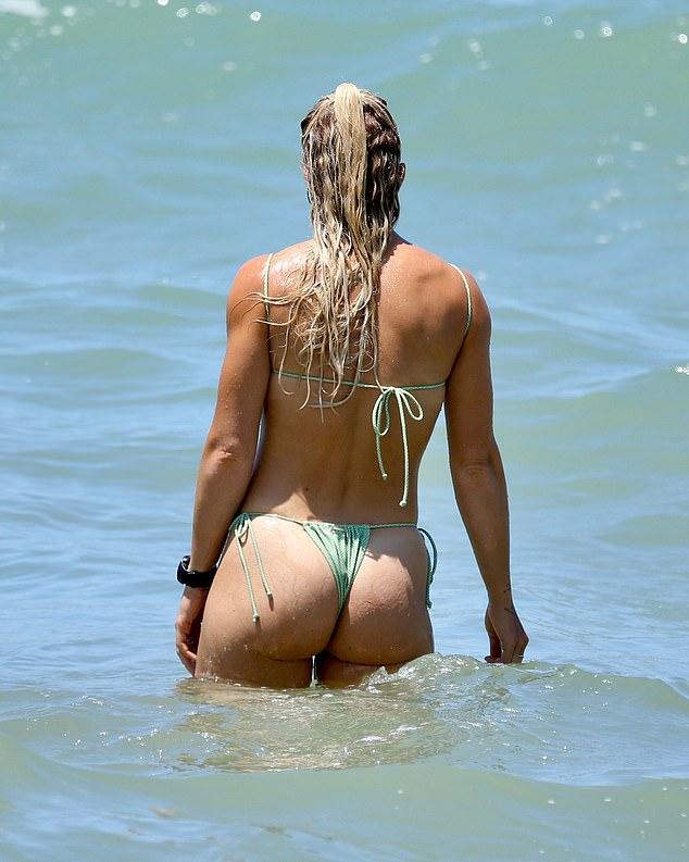 Splashing around: She seemed to enjoy wading through the salty water