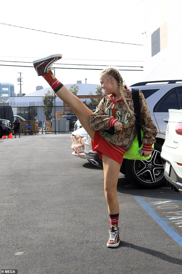 Flexible: Dancing with the Stars frontrunner JoJo Siwa showed off her high kick outside the LA rehearsal studio on Wednesday before prepping for the two Disney-themed episodes