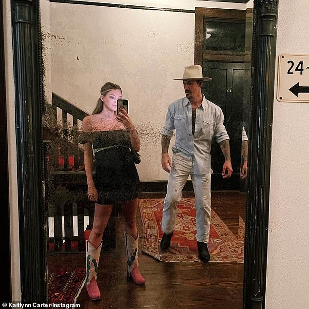 Mom and dad: Kaitlynn showed off her cowboy boots as she posed with her beau in the mirror back in July