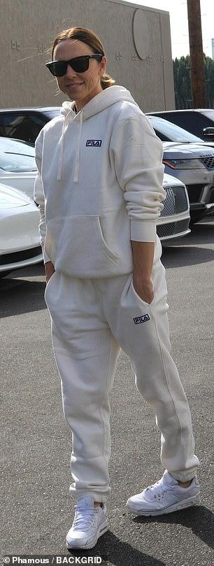 She sported white FILA sweats for rehearsal