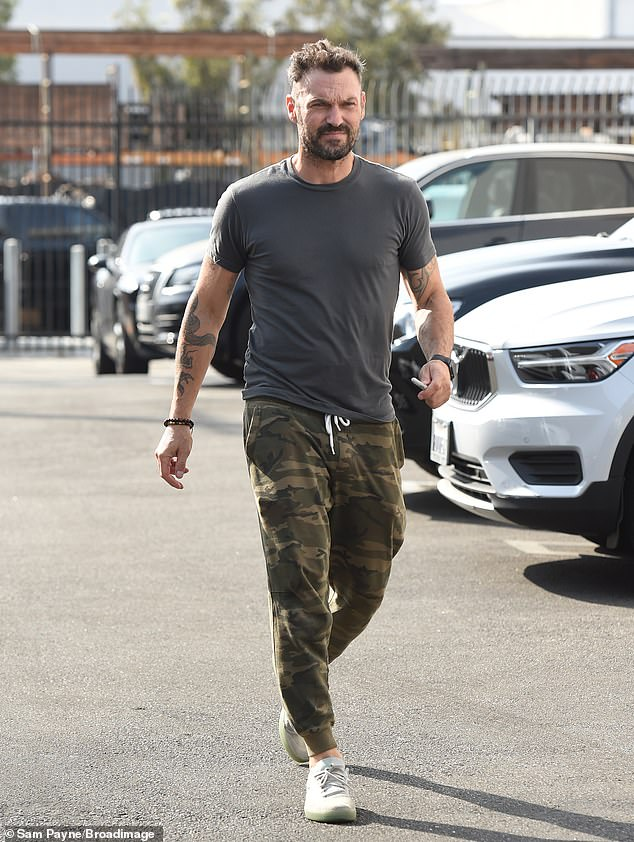 12th place:BH90210 alum Brian Austin Green - who also competed on The Masked Singer last year - strolled into rehearsal wearing a grey T-shirt and camoflauge joggers