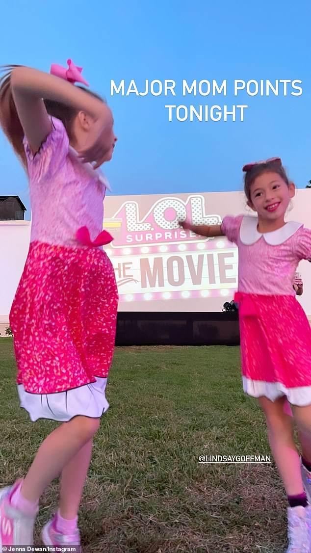 Twinning! The former back-up dancer scored 'major mom points' by bringing her eight-year-old daughter Everly (L) as well as her friend's daughter Maddie (R) to the event