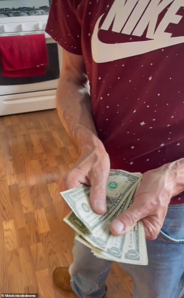 In other clips, she gives details about items Michael has bought for her over the years, including several Louis Vuitton bags, and reveals how he hands over his wads of cash (pictured)