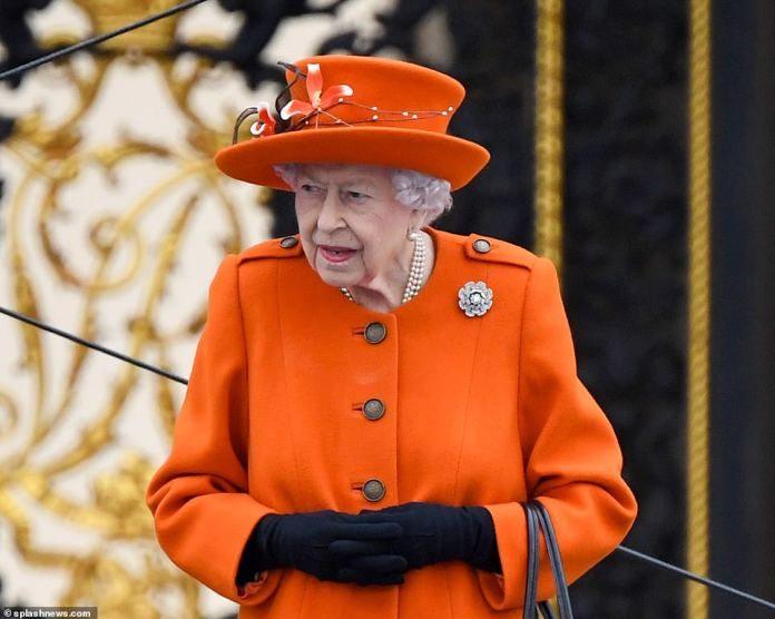 The emperor chose a sparkling orange ensemble for the occasion and draped it with dark gloves.