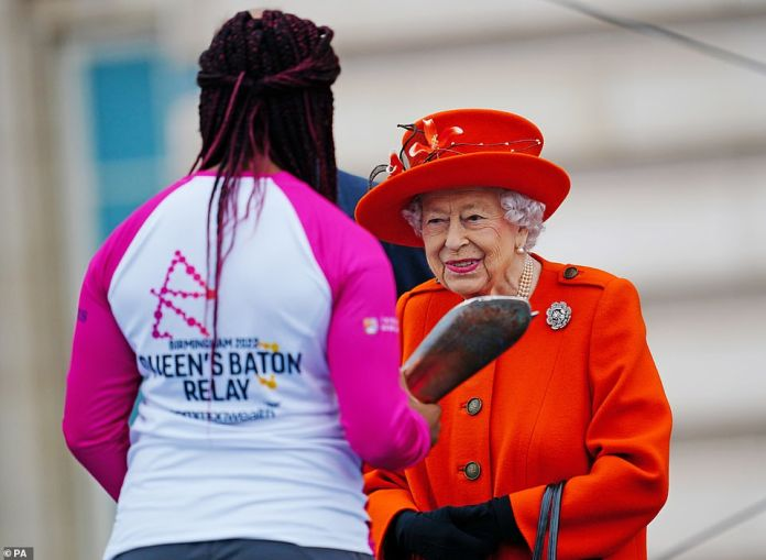 The monarch can be seen chatting with the first baton bearer, British parasport athlete Kadina Cox, at the launch of the Queen's Baton Relay for Birmingham 2022.