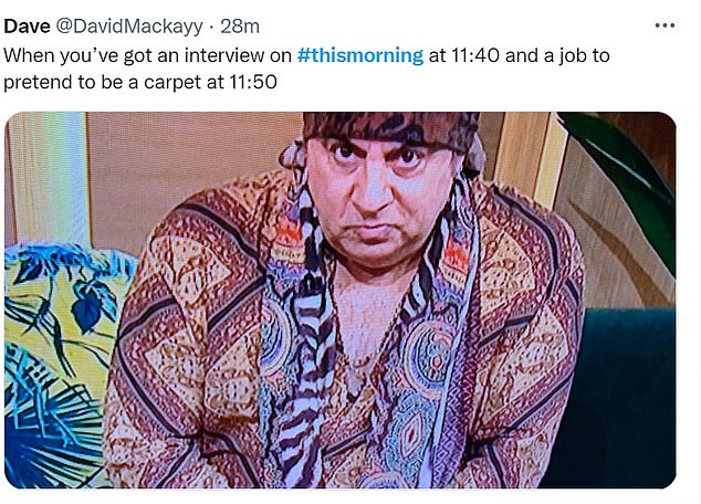 Reaction: Viewers were left distracted by Steven¿s attire, which included a colourful patchwork shirt, undone to show his chest, teamed with a vibrant scarf and matching headwear
