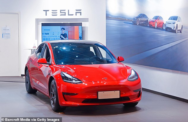 Industry experts speculate is due to the global chip shortage that is expected to linger until 2023. Pictured is a Tesla Model y
