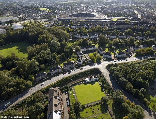 A drone shot shows the stricken bowling club (bottom) and the current Hampden Park (top)