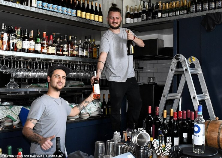Staff making sure they are fully stocked with alcohol and food as they prepare for reopening in Sydney on Monday
