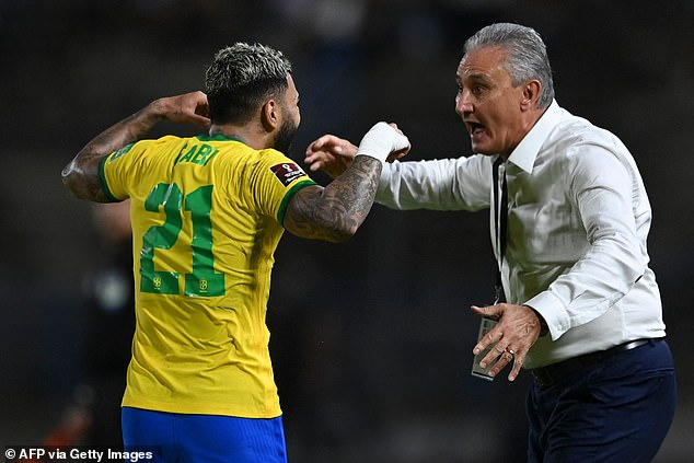 Barbosa celebrates his late penalty with Brazil head coach Tite on Thursday evening