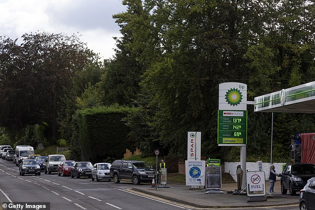 The Petrol Retailers Association's survey shows that 12 per cent of filling stations have run out of fuel, while 17 per cent have one grade of diesel or petrol in London and south-east England. Pictured: People queuing for fuel at a BP station in West Malling on October 5