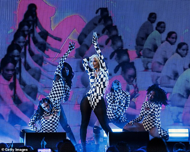 , Iggy Azalea showcases her famous curves in a checkered bodysuit, The Today News USA