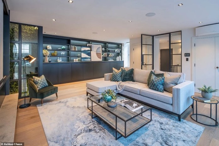 The Love Me Like You Do singer, 34, placed her five-story semi-detached townhouse (pictured) in Marylebone, with dramatic tall windows, a trendy spiral staircase and an array of Gagneau integrated appliances, marketed for £5.95 million is in.  in october last year